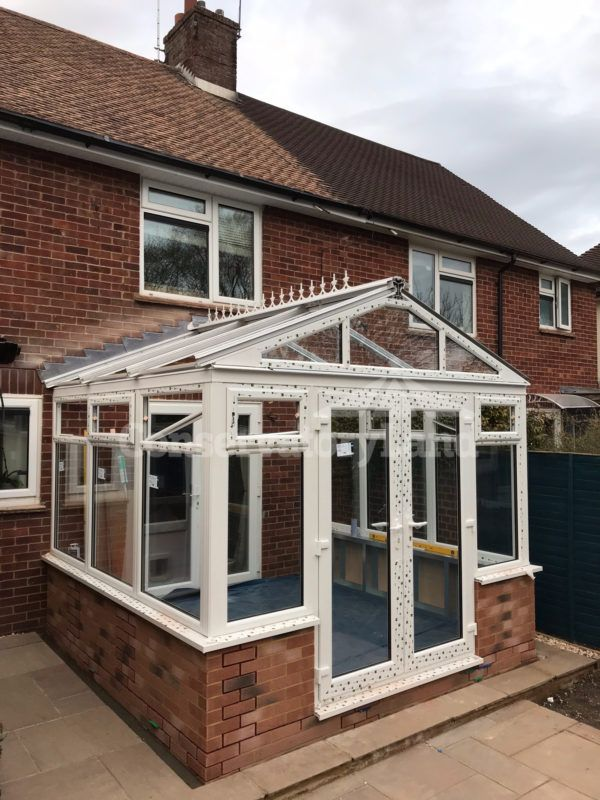 Gable front with self cleaning, solar control glazing, high vaulted roof